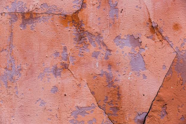 Farbe und risse auf der zementwandoberfläche Kostenlose Fotos