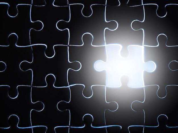 Fehlendes puzzlestück mit beleuchtung, geschäftskonzept für das abschließen des vollendenpuzzlestücks. Premium Fotos