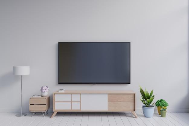 Fernsehapparat auf dem kabinett im modernen wohnzimmer mit anlage auf weißem wandhintergrund Premium Fotos