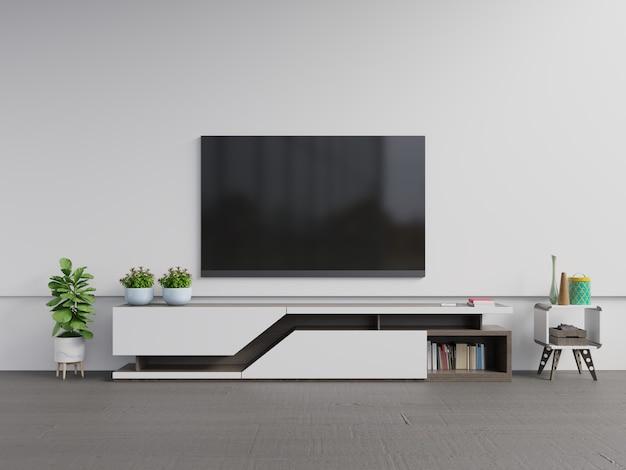 Fernsehapparat auf dem kabinett im modernen wohnzimmer mit anlage Premium Fotos