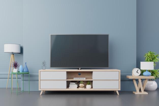 Fernsehen auf modernem innenraum des kabinetts mit anlagen, regal, lampe auf dunkelblauer wand. Premium Fotos