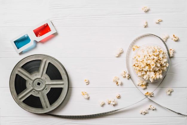 Filmspule und popcorn mit brille Kostenlose Fotos