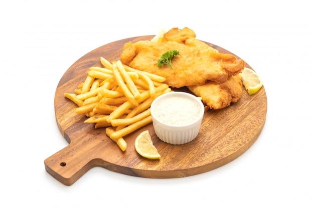 Fisch und pommes mit pommes frites Premium Fotos