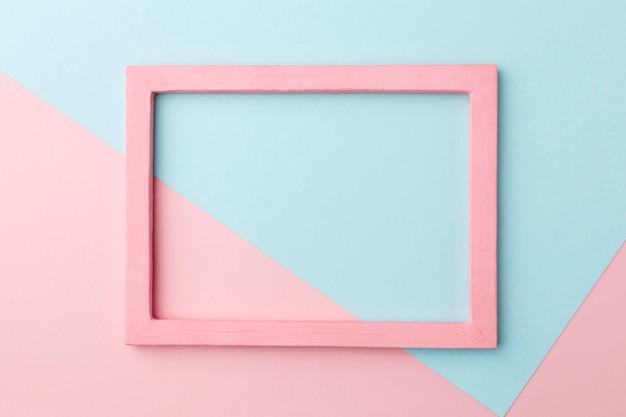 Flache lage des schönen rosa holzrahmenkonzepts Kostenlose Fotos