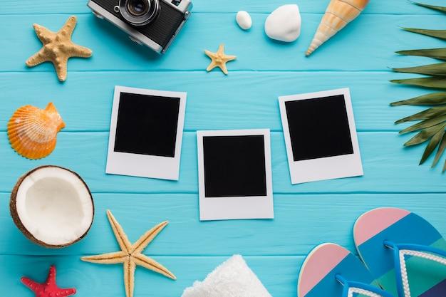 Flache lageferienzusammensetzung mit polaroidbildern Kostenlose Fotos