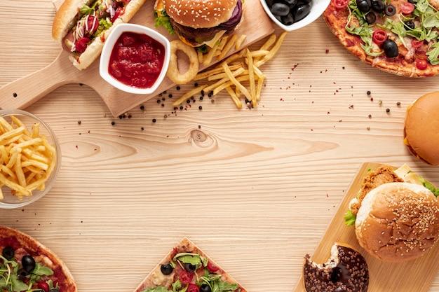 Flacher, runder rahmen mit leckerem fast food Kostenlose Fotos