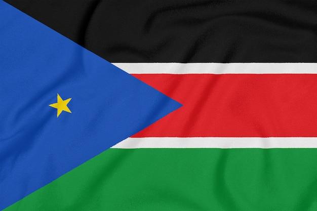 Flagge des südsudan auf strukturiertem gewebe. Premium Fotos