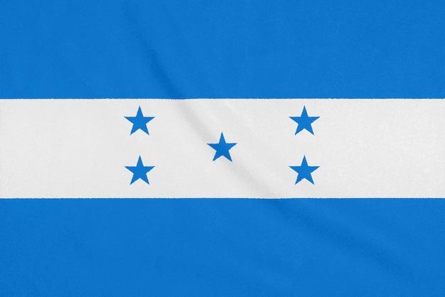 Flagge von honduras auf strukturiertem gewebe. Premium Fotos