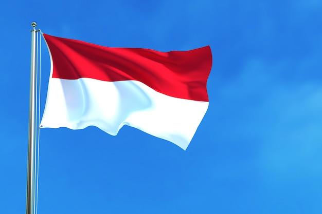 Flagge von indonesien auf dem hintergrund des blauen himmels Premium Fotos