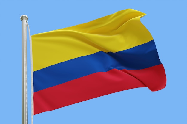 Flagge von kolumbien auf fahnenmast, der im wind weht. auf blauem himmel isoliert Premium Fotos