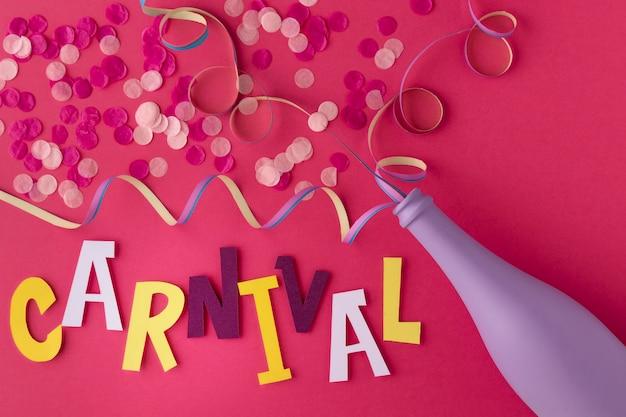 Flasche mit konfetti für den karneval Premium Fotos