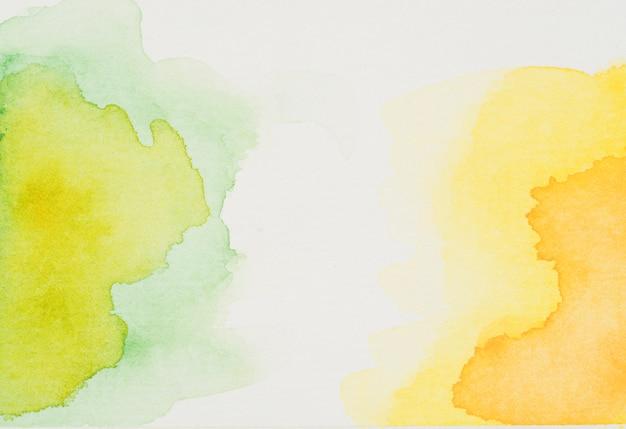 Flecken von grünem und gelbem aquarell Kostenlose Fotos