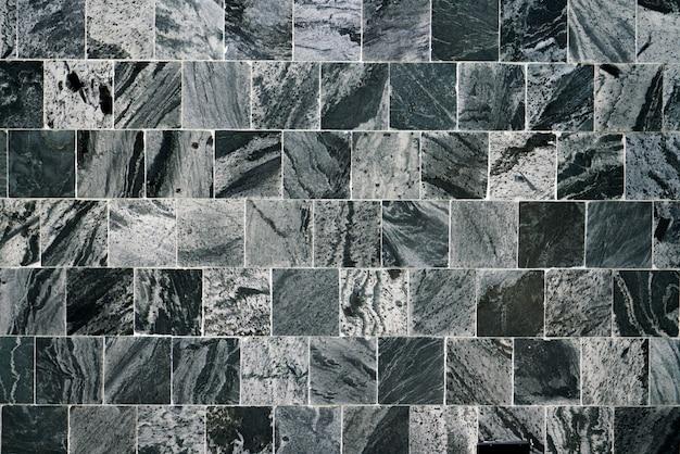 Fliesenhintergrund u. -tapete des schwarzen quadrats Premium Fotos