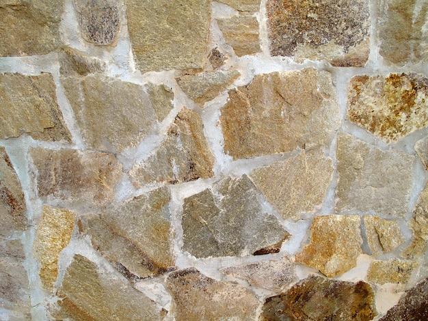 Foto einer einfachen steinmauer für hintergrund Premium Fotos
