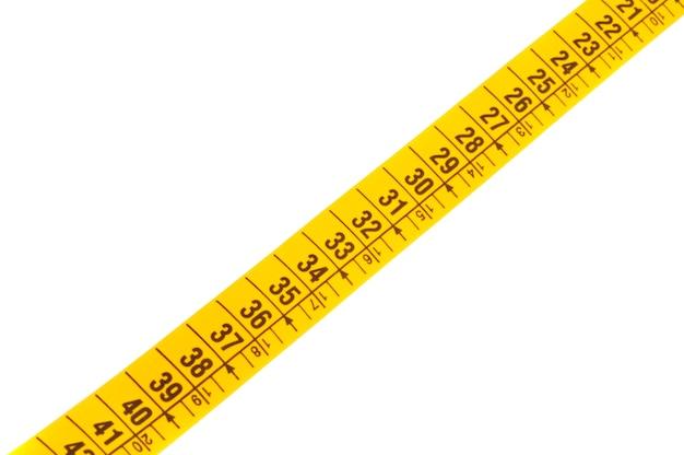 Foto eines messenden bands a über weißem hintergrund Premium Fotos