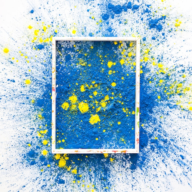 Fotorahmen auf den blauen und gelben hellen trockenen farben Kostenlose Fotos