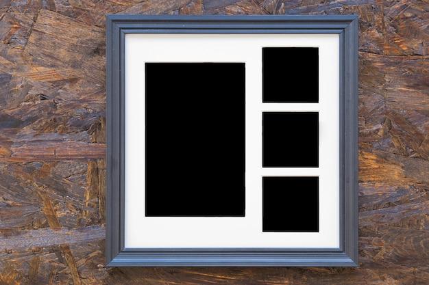 Fotorahmen auf hölzernem strukturiertem hintergrund Kostenlose Fotos