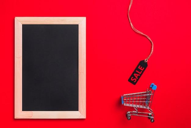 Fotorahmen, einkaufswagen und aufkleber mit verkaufstitel Kostenlose Fotos