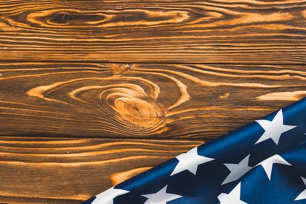 Fragment der usa-flagge auf hölzernem hintergrund Kostenlose Fotos