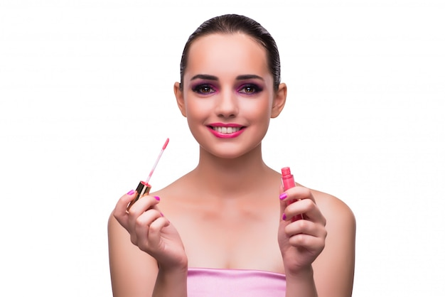 Frau, die den lippenstift lokalisiert anwendet Premium Fotos