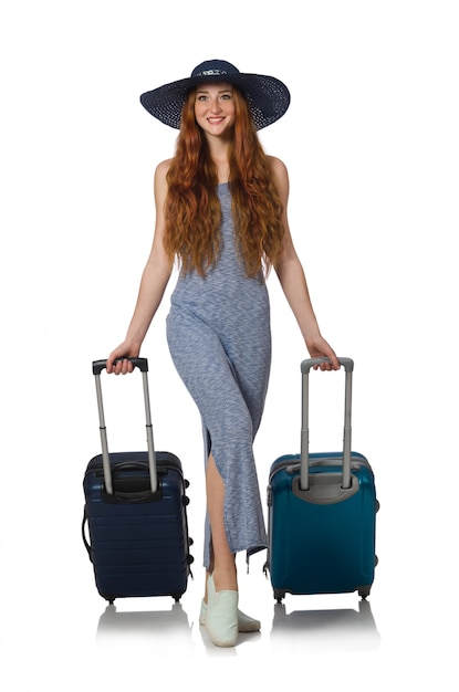Frau, die für sommerferien auf weiß sich vorbereitet Premium Fotos