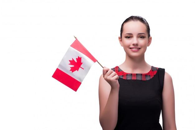Frau, die kanadische flagge lokalisiert auf weiß hält Premium Fotos