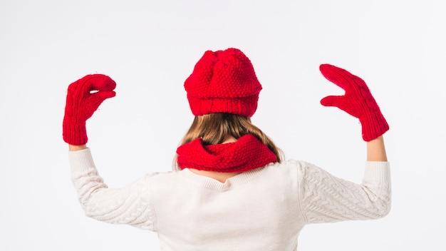 Frau in der roten kappe mit handschuhmarionetten Kostenlose Fotos