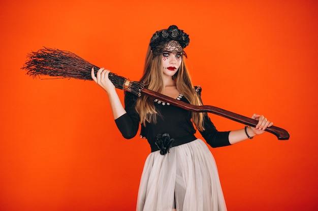 Frau in einem halloween-kostüm Kostenlose Fotos