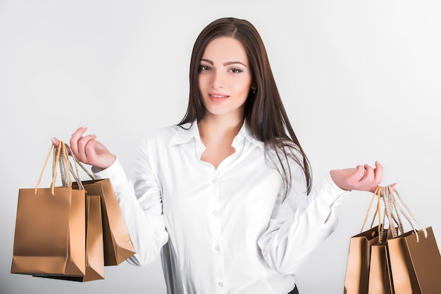 Frau mit einkaufstüten Premium Fotos