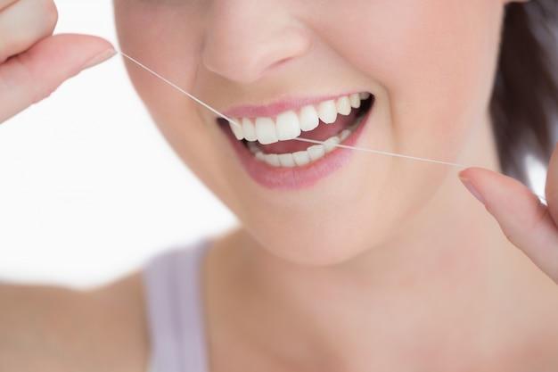 Frau mit zahnseide Premium Fotos