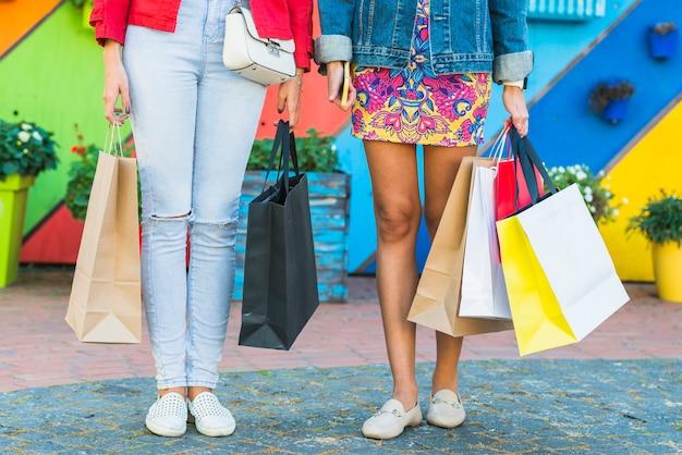Frauen mit einkaufstüten Kostenlose Fotos