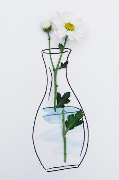Frische blume auf papier mit gezogenem vase platziert Kostenlose Fotos
