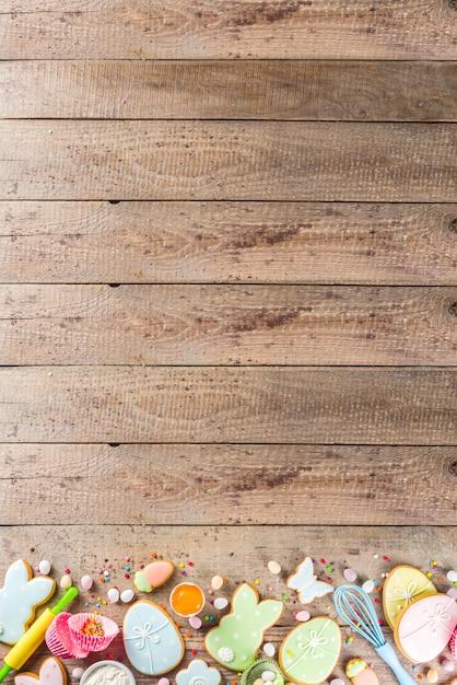 Frohe ostern backen hintergrund Premium Fotos
