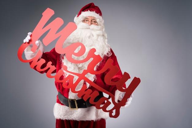 Frohe weihnachten mit dem weihnachtsmann Kostenlose Fotos