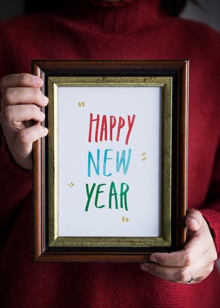 Frohes neues Jahr in einem Rahmen | Download der kostenlosen Fotos