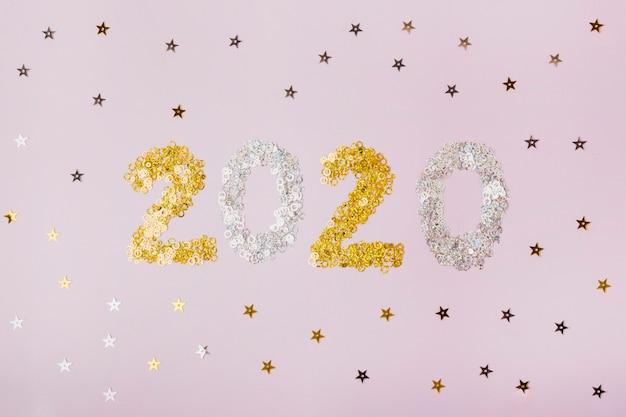 Frohes neues jahr mit den nummern 2020 mit goldenen sternen Kostenlose Fotos