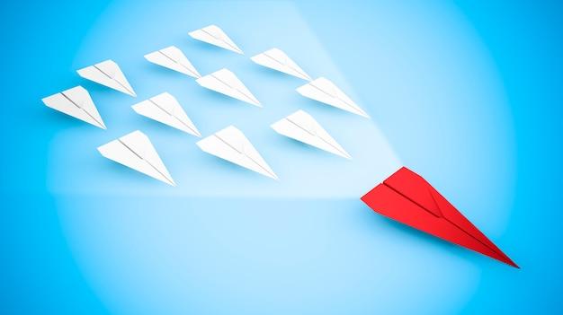 Führungskonzept mit papierflugzeugen: das rote flugzeug schneller Premium Fotos