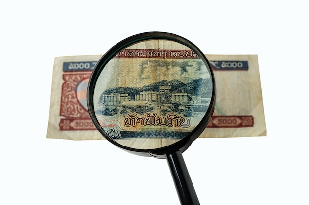 Fünftausend laos kip bill und eine lupe Premium Fotos