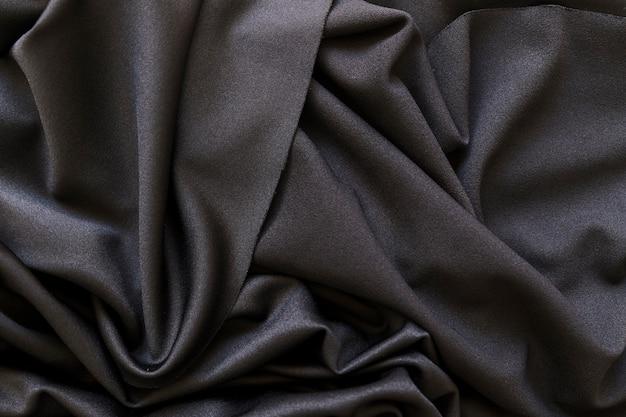 Full-frame-aufnahme von glatten schwarzen stoff Premium Fotos
