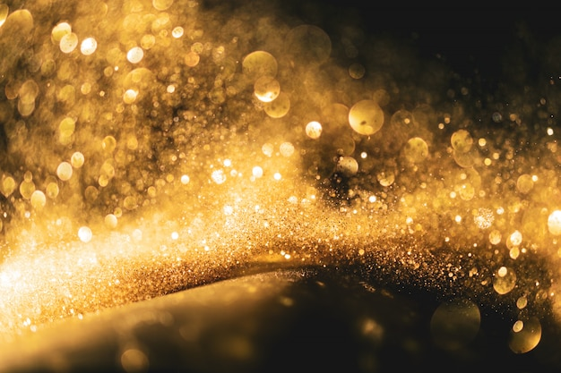 Funkeln beleuchtet grunge hintergrund, defocused abstrakter funkelnder lichthintergrund des goldfunkelns. Premium Fotos