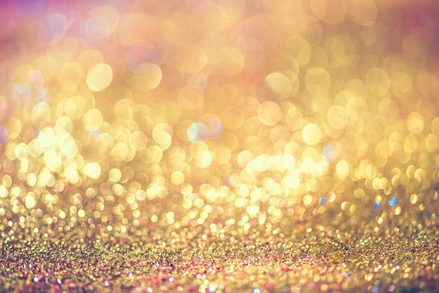 Funkelngold-bokeh colorfull verwischte abstrakten hintergrund für geburtstag, jahrestag, hochzeit Premium Fotos