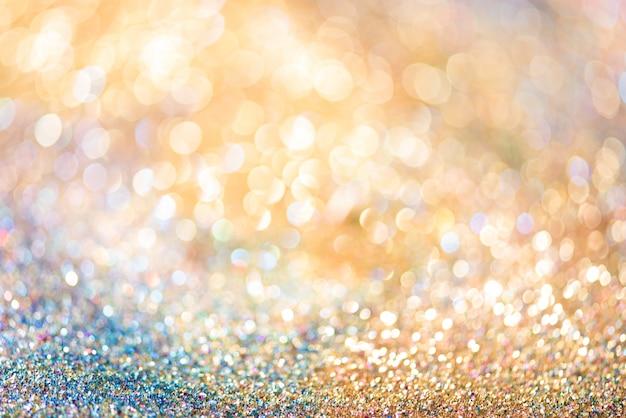 Funkelngoldbokeh colorfull unscharfer abstrakter hintergrund für jahrestag Premium Fotos