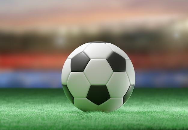 Fußballkugel auf dem feld eines stadions Premium Fotos