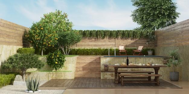 Garten auf zwei ebenen mit altem esstisch auf deckboden Premium Fotos
