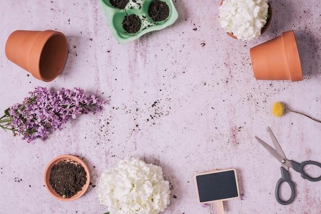 Gartenarbeitkonzept der flachen lage mit copyspace Kostenlose Fotos