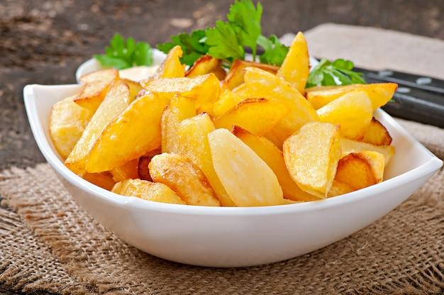 Gebratene kartoffelschnitze Kostenlose Fotos