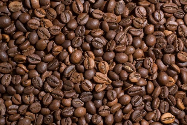 Gebratener brauner kaffeebohnehintergrund Premium Fotos