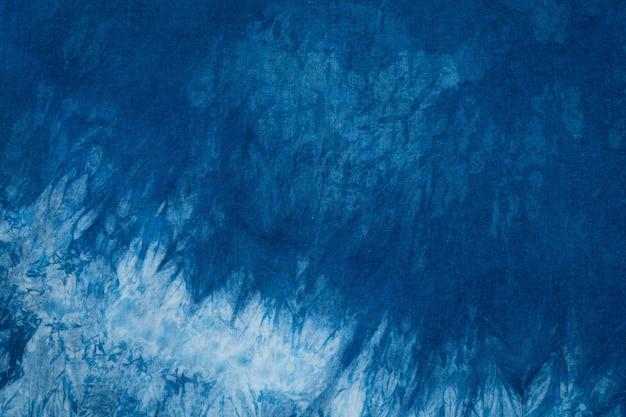 Gefärbte indigo stoff hintergrund und strukturiert Premium Fotos