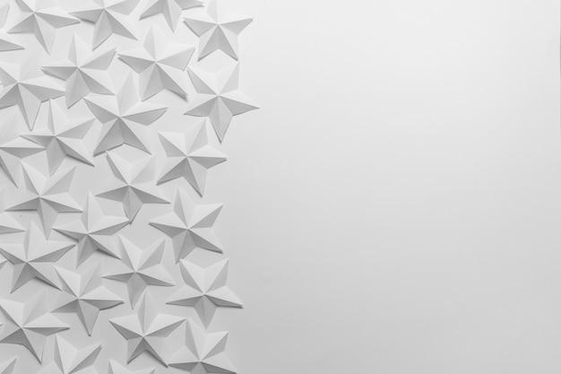 Gefaltete weiße origami-sterne Premium Fotos