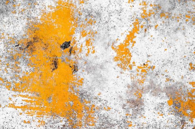 Gelbe farbe der schmutzbetonmauer für beschaffenheitshintergrund Premium Fotos